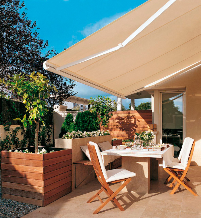 Toldos para terrazas toldos y persianas alhambra granada for Toldos triangulares para terrazas